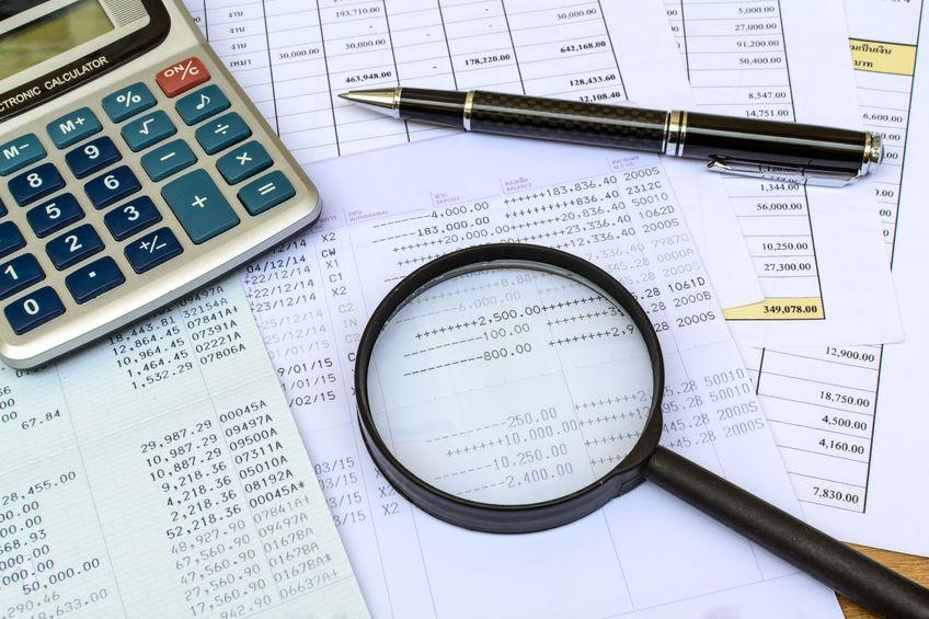 photo of calculator, receipts, calculator for cost to create e-learning